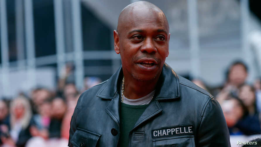 Actor Dave Chappelle arrives at the Toronto International Film Festival in Toronto, Canada, Sept. 9, 2018. The comedian will host a block party in Dayton, Ohio, to benefit those affected by the recent shooting.