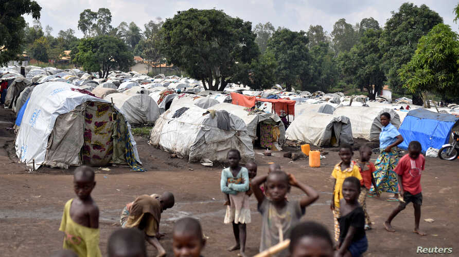 FILE - Victims of ethnic violence are seen at a makeshift camp for the internally displaced people in Bunia, Ituri province in the eastern Democratic Republic of Congo, June 25, 2019.