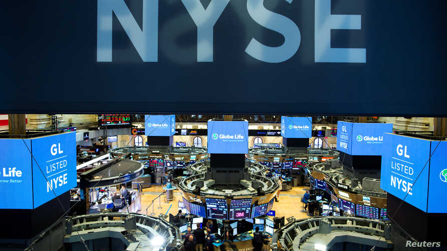 Traders work on the floor at the New York Stock Exchange (NYSE) in New York, U.S., August 12, 2019.