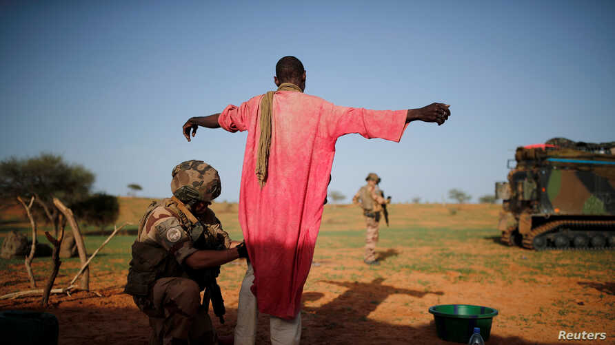 A French soldier of the 2nd Foreign Engineer Regiment searches a man during an area control operation in the Gourma region during Operation Barkhane in Ndaki, Mali, July 27, 2019.