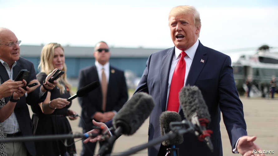 U.S. President Donald Trump speaks to reporters as he boards Air Force One for travel to New Hampshire from Morristown Municipal Airport in Morristown, New Jersey, Aug. 15, 2019.