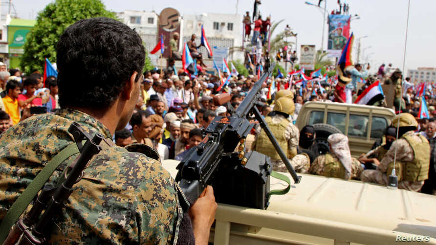 FILE - Members of UAE-backed southern Yemeni separatists forces are seen together with their supporters as they march.