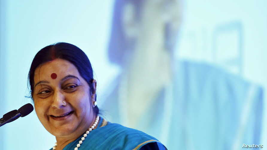 FILE - India's Foreign Minister Sushma Swaraj smiles while addressing the India Africa business forum in New Delhi, India, Oct. 28, 2015.
