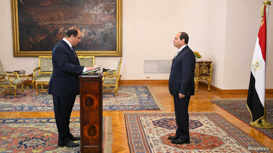 Egyptian President Abdel Fattah al-Sisi (R) listens to the swearing in of Major General Abbas Kamel, newly appointed chief of the country's General Intelligence Service at the Ittihadiya presidential palace in Cairo, Egypt, June 28, 2018.