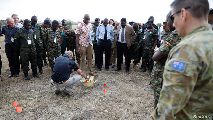 High-level improvised explosive device (IED) specialists from Africa and Western partners attend a demonstration of a post-blast IED investigation during a seminar at the Humanitarian and Peace Support School at Embakasi in Nairobi, Kenya, July 31, 2019.