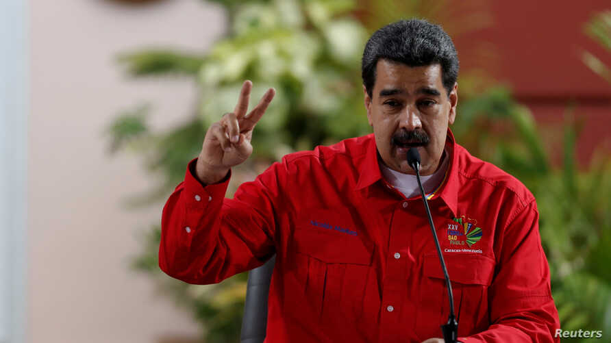 FILE - Venezuela's President Nicolas Maduro speaks at a meeting of the Sao Paulo Forum in Caracas, Venezuela, July 28, 2019.