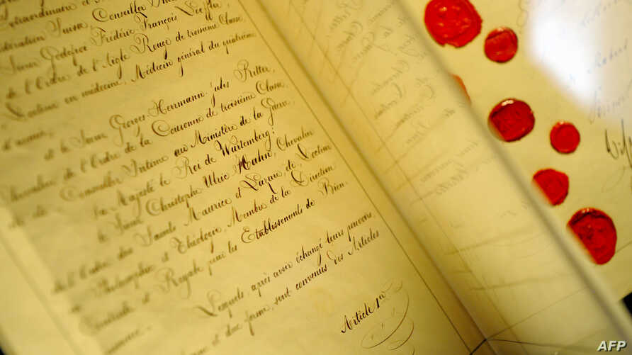 """FILE - The original document of the 1st Geneva Convention """"for the Amelioration of the Condition of the Wounded in Armies in the Field"""" signed in 1864 is seen at the International Red Cross and Red Crescent Museum in Geneva, Switzerland."""