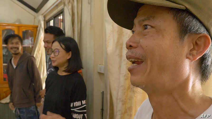 """This screen grab from video footage shows Faiyen band members (from L to R) Nithiwat """"Jom"""" Wannasiri, Worravut """"Tito"""" Thueakchaiyaphum, Romchalee """"Yammy"""" Sombulrattanakul and Trairong """"Khunthong"""" Sinseubpol, July 9, 2019, at an undisclosed location in Laos."""