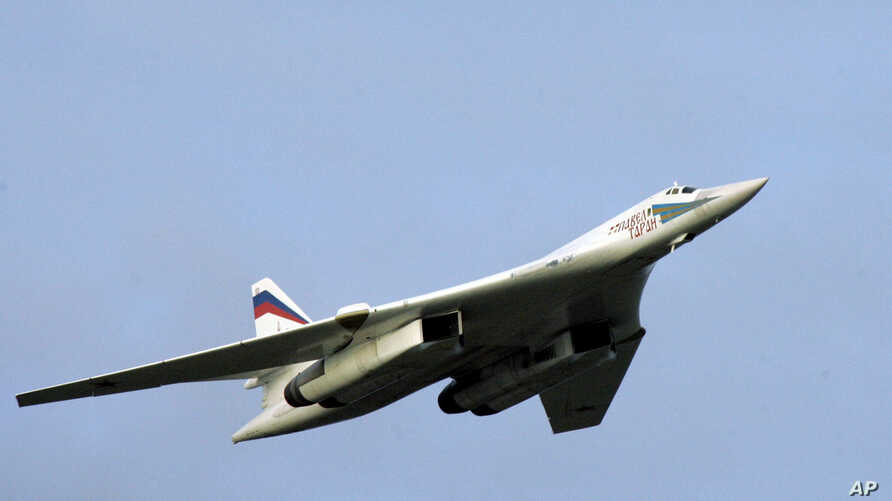 A TU-160 strategic bomber flies above an airfield near the northern city of Murmansk, Russia, Aug. 16, 2005.