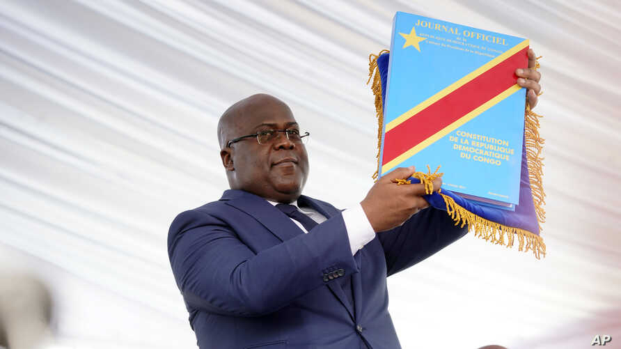 Congolese President Felix Tshisekedi holds the constitution after being sworn in in Kinshasa, Democratic Republic of the Congo, Jan. 24, 2019.