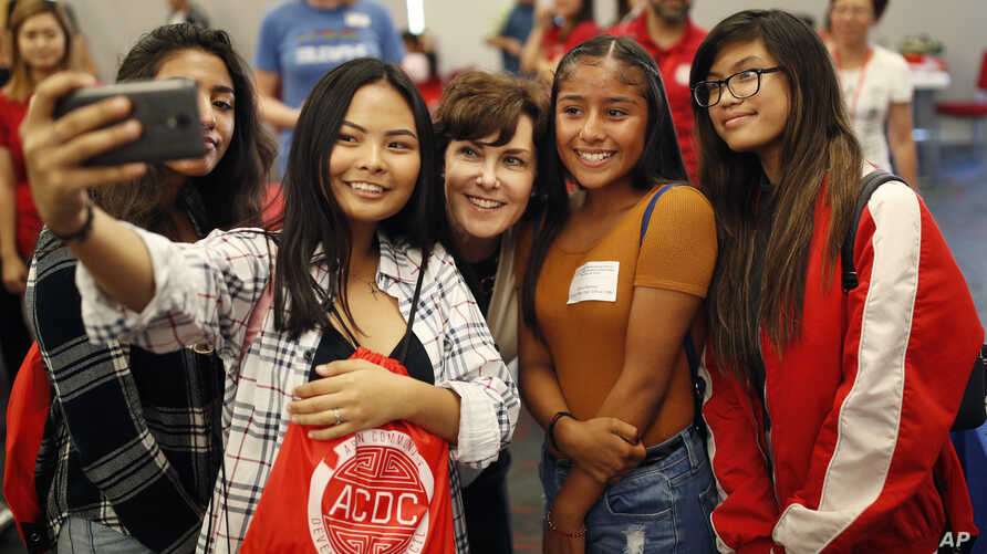 FILE - Rep. Jacky Rosen, D-Nev., center, poses for a selfie with high school students at an event put on by the Asian Community Development Council in Las Vegas, Sept. 29, 2018.