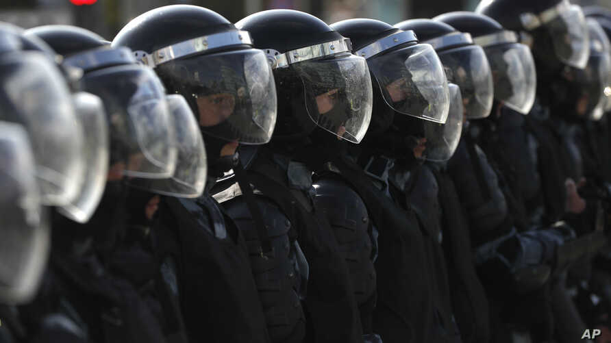 Police block a street during an unsanctioned rally in the center of Moscow, Russia, Aug. 3, 2019.
