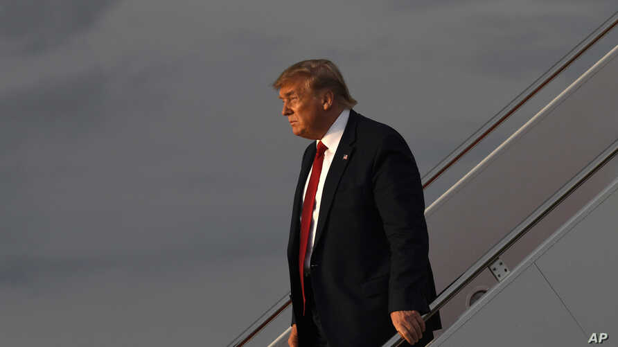 President Donald Trump walks down the steps of Air Force One at Andrews Air Force Base in Maryland, Aug. 21, 2019, after returning from Louisville, Kentucky, where he spoke to the American Veterans (AMVETS) 75th National Convention.
