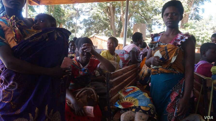 Some women in Malawi have had their uteruses involuntarily removed soon after giving birth in procedures that have come under scrutiny. Pictured here are mothers attending a clinic with their children the at Likuni clinic in the capital Lilongwe.
