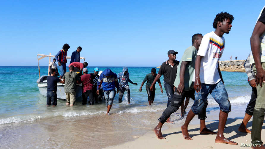 Migrants are seen after being rescued by the Libyan coast guard in Tripoli, Libya July 26, 2019.