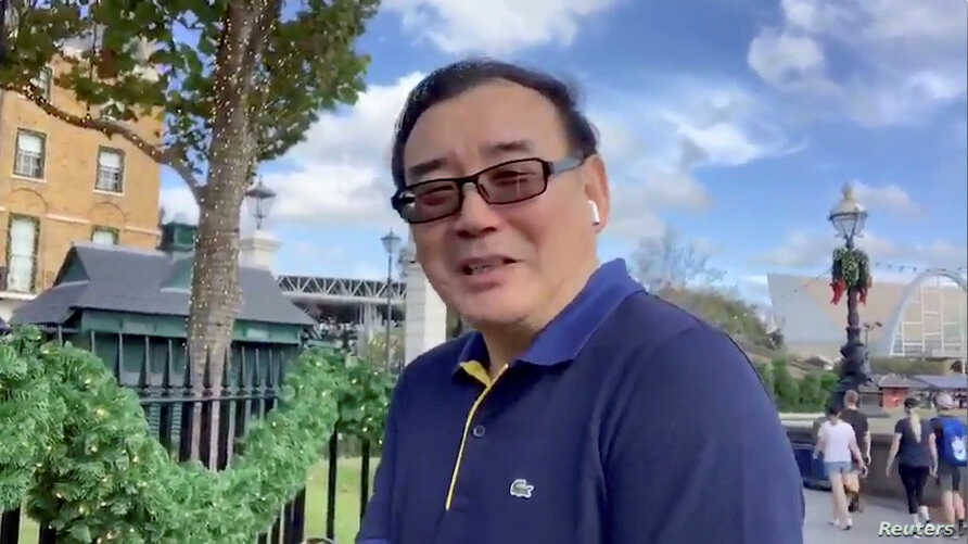 Australian writer Yang Hengjun wishes Happy New Year to his Twitter followers at an unidentified location in this still image from an undated video obtained via social media. (Twitter @YANGHENGJUN)