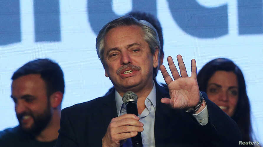 Presidential candidate Alberto Fernandez speaks during the primary elections, at a cultural center in Buenos Aires, Argentina, Aug. 11, 2019.