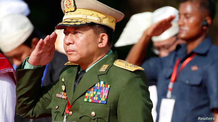 Myanmar's military Commander in Chief Senior Gen. Min Aung Hlaing salutes as he attends an event marking the 72nd anniversary of Martyrs' Day at the Martyrs' Mausoleum dedicated to the fallen independence heroes, in Yangon, July 19, 2019.
