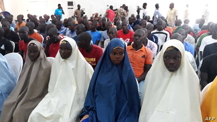 FILE - Children cleared of ties with Boko Haram wait to be released by the military in Maiduguri, July 9, 2018.