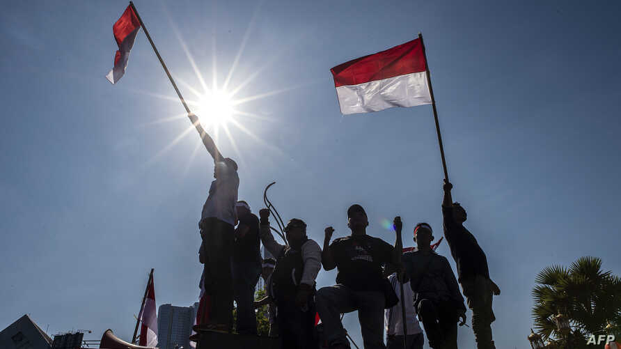 Indonesian activists gather in Surabaya to promote peace in Indonesia's Papua region, Sept. 2, 2019.