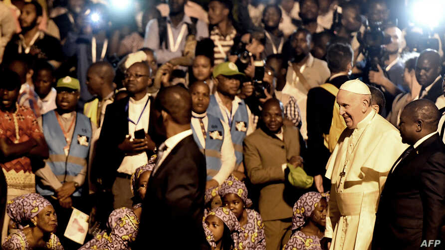 Pope Francis attends a welcome ceremony flanked by Mozambique President Filipe Nyusi upon his arrival at the Maputo International Airport in Maputo, Mozambique, Sept. 4, 2019.