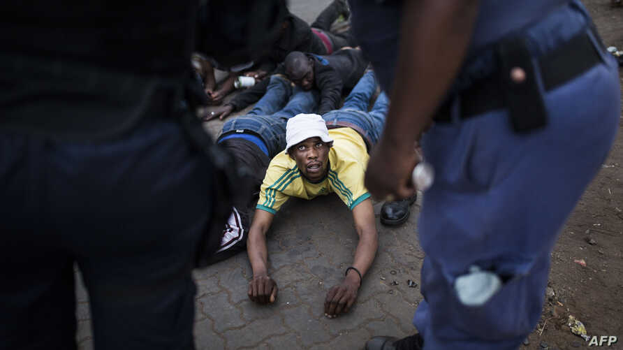 A man is arrested by members of the Ekurhuleni Metropolitan Police in Johannesburg Katlehong Township, during anti-foreigner violence, Sept. 5, 2019.