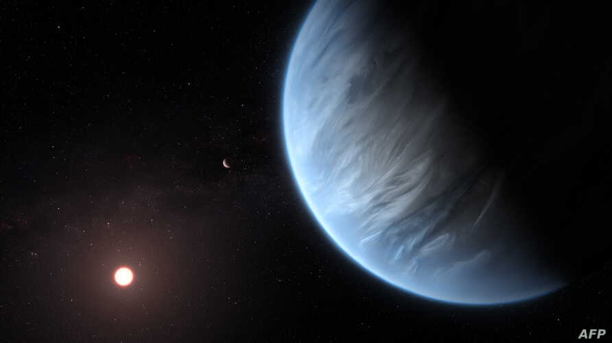 A handout artist's impression released Sept. 11, 2019, by ESA/Hubble shows the K2-18b super-Earth, the only super-Earth exoplanet known to host both water and temperatures that could support life.