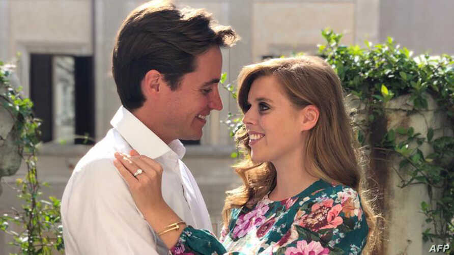 Britain's Princess Beatrice of York, right, poses with her finacee Edoardo Mapelli Mozzi in Italy, in this undated handout picture released by Buckingham Palace and taken by Britain's Princess Eugenie of York.
