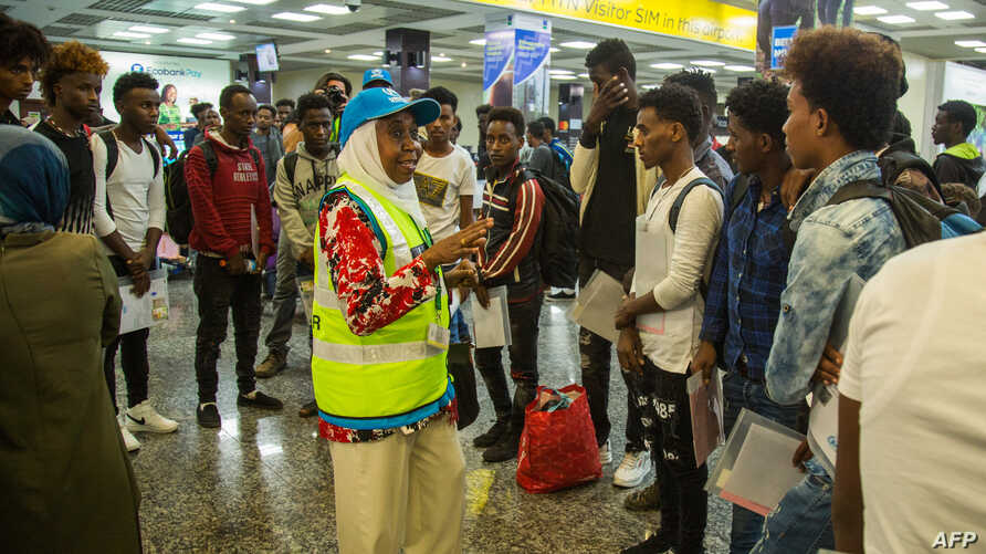 This handout picture from Rwanda's Ministry of Emergency Management taken Sept. 26, 2019, shows the arrival of refugees and asylum seekers from Libya at the Kigali international airport in Kigali, Rwanda.