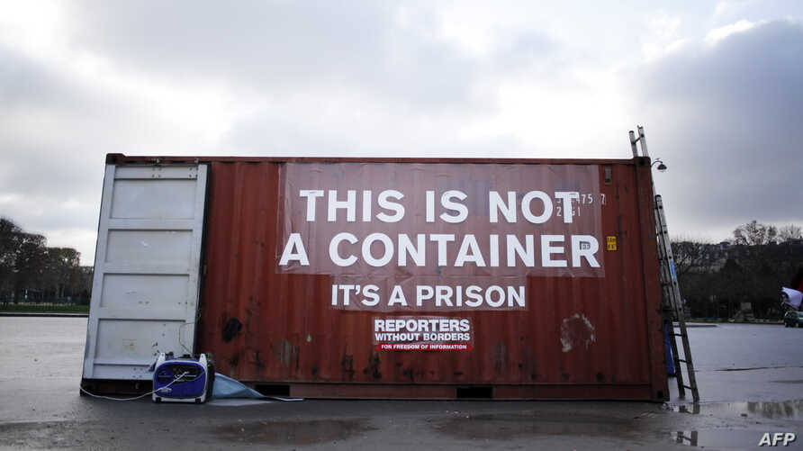 "FILE - A shipping container bearing the slogan ""This is not a container, it is is prison"" stands in position during a demonstration by Reporters Without Borders in support of imprisoned journalists, including those from Eritrea, in Paris, Dec. 16, 2014."