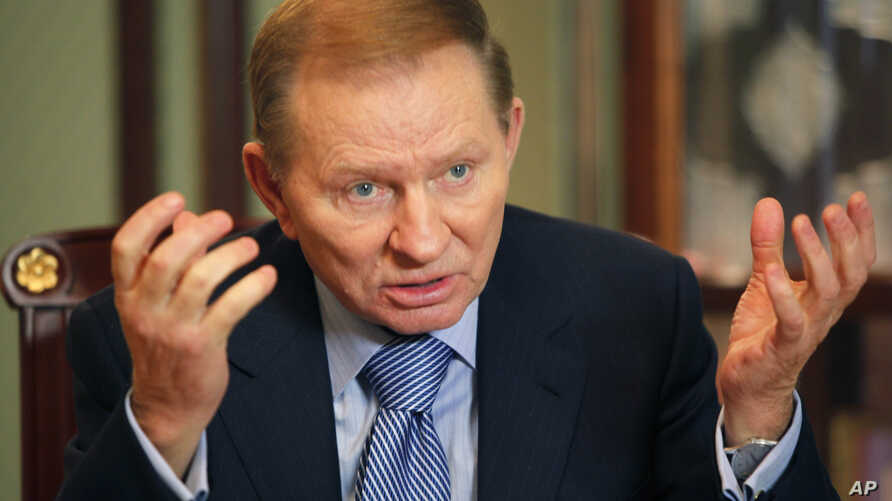FILE - Former Ukrainian president Leonid Kuchma gestures during an interview with The Associated Press in Kyiv, Ukraine, Feb. 5, 2010.