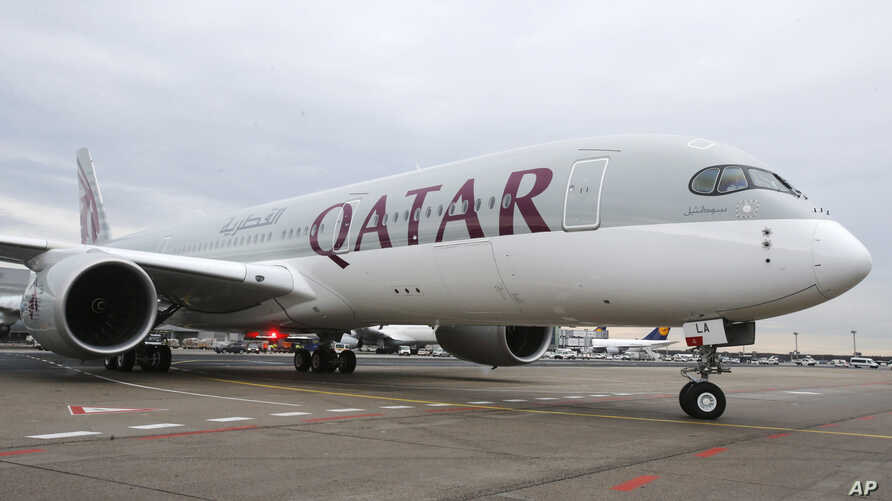 FILE - A Qatar Airways Airbus A350 approaches the gate at the airport in Frankfurt, Germany, Jan. 15, 2015.