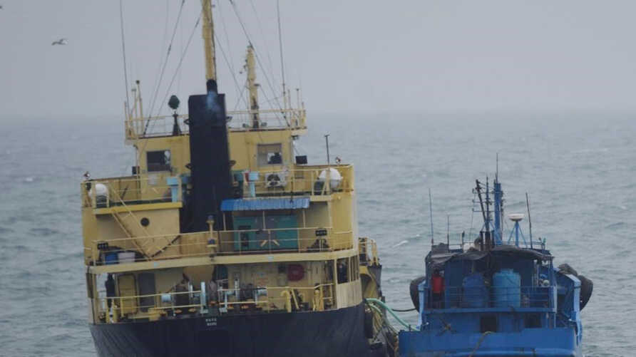 """FILE - This photo released by Japan's Ministry of Defense shows what it says is the North Korean-flagged tanker Yu Jong 2, left, and Min Ning De You 078 lying alongside in the East China Sea, Feb. 16, 2018. China says it is """"highly concerned"""" about a reported ship-to-ship transfer that could violate U.N. sanctions on North Korea."""