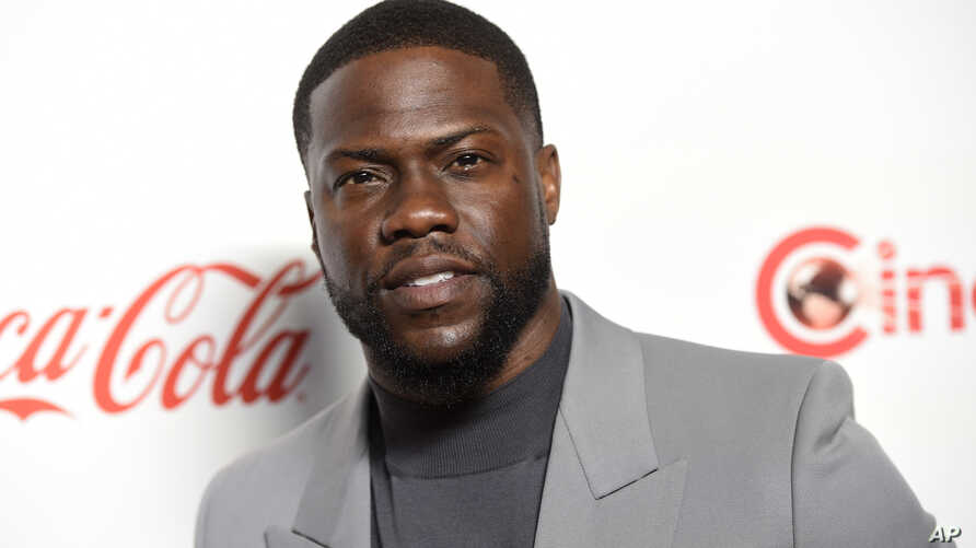 FILE - Kevin Hart, recipient of the CinemaCon international star of the year award, poses at the Big Screen Achievement Awards at Caesars Palace in Las Vegas, April 4, 2019.