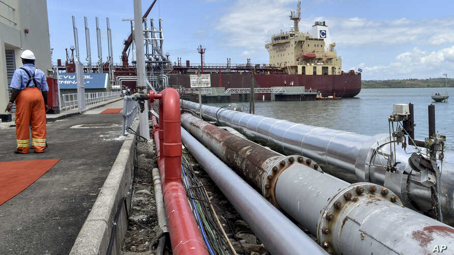 The Celsius Riga tanker carrying Kenya-produced crude oil, sits docked during a ceremony at the Kipevu oil terminal at the port in Mombasa, Kenya, Aug. 26, 2019.