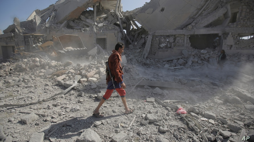 A Yemeni man walks amid the rubble of a Houthi-held detention center destroyed by Saudi-led airstrikes in Dhamar, Yemen, Sept. 1, 2019.