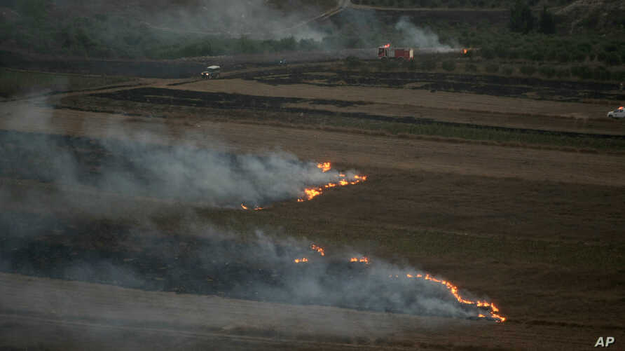 Flames and smoke rise from where Israeli army shells that landed in the southern Lebanese border village of Maroun Al-Ras, Lebanon, Sept. 1, 2019.