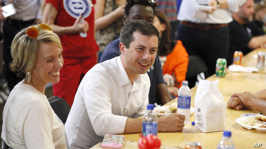 Democratic presidential candidate Pete Buttigieg speaks with local residents at the Hawkeye Area Labor Council Labor Day Picnic in Cedar Rapids, Iowa, Sept. 2, 2019.