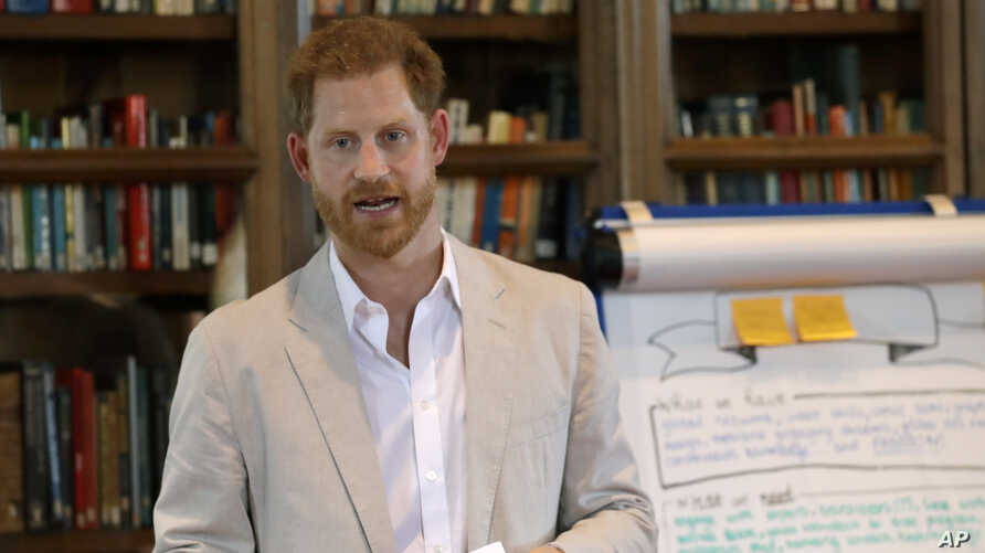 FILE - Britain's Prince Harry delivers a speech as he attends Dr. Jane Goodall's Roots & Shoots Global Leadership Meeting at St. George's House, Windsor Castle in England, July 23, 2019.