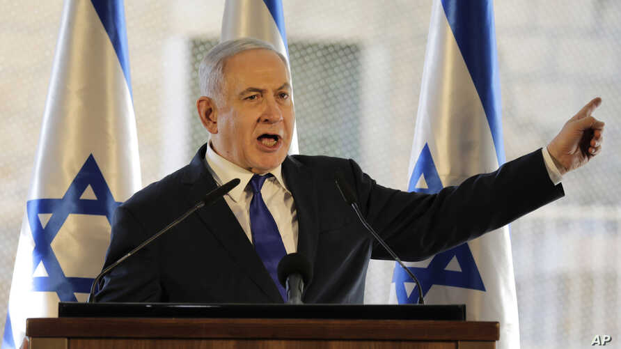 Israeli Prime Minister Benjamin Netanyahu, gestures as he speaks during a ceremony near Hebron's holiest site, known to Jews as the Tomb of the Patriarchs and to Muslims as the Ibrahimi Mosque in Hebron, Sept. 4, 2019.