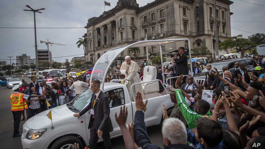 Pope Francis waves to wellwishers as he leaves after a meeting at the Cathedral of the Immaculate Conception in the capital Maputo, Mozambique, Sept. 5, 2019.