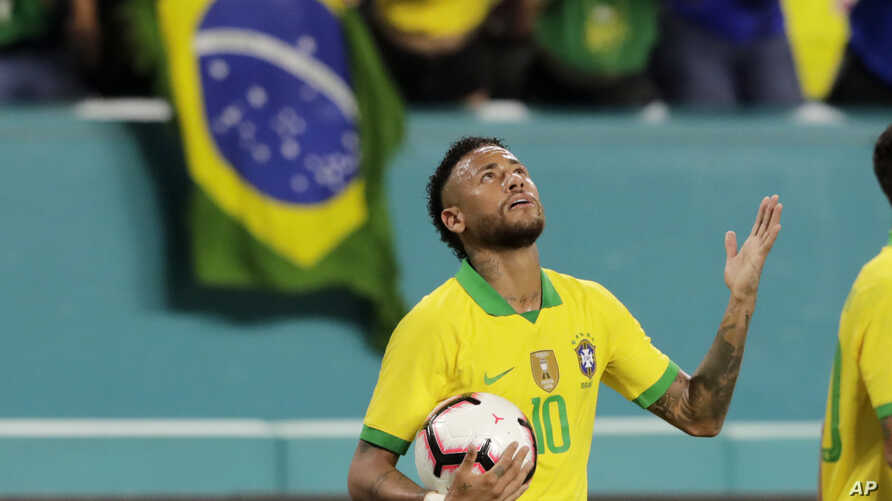 Brazil forward Neymar reacts after scoring a goal during the second half of a friendly soccer match against Colombia, Sept. 6, 2019, in Miami Gardens, Fla.