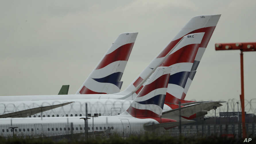 British Airways planes sit parked at Heathrow Airport in London, Sept. 9, 2019. British Airways says it has had to cancel almost all flights as a result of a pilots' 48-hour strike over pay.