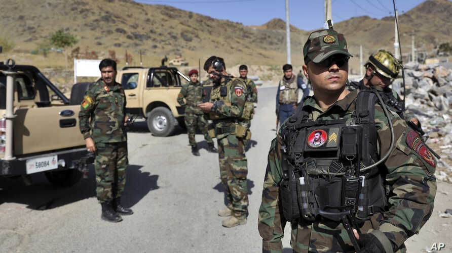 FILE - Afghan special forces stand guard at the site of a suicide car bomb explosion that killed at least four people, on the outskirts of Kabul, Afghanistan, Sept. 12, 2019. The Taliban claimed responsibility in a statement sent to the media.