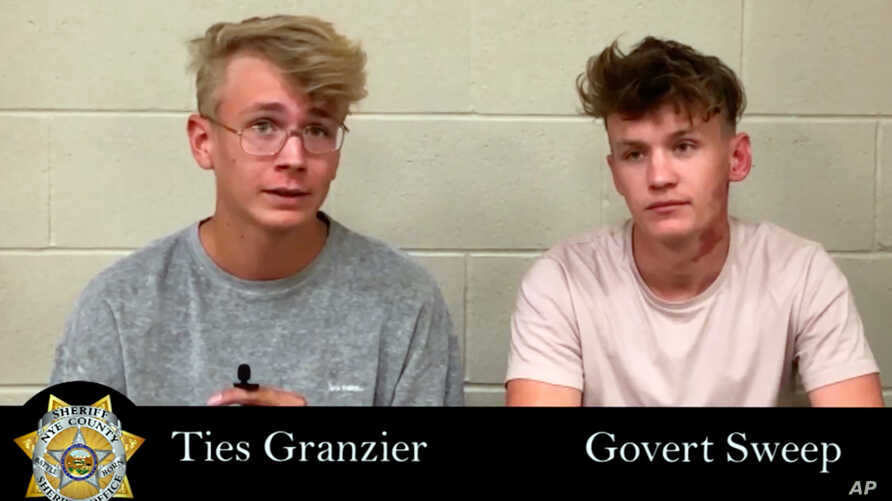 This image taken from video posted by the Nye County Sheriff's Office on Tuesday, Sept. 17, 2019, shows a recorded police interview with Dutch tourists Ties Granzier, left, and Govert Sweep, in the Nye County Jail in Pahrump, Nevada.