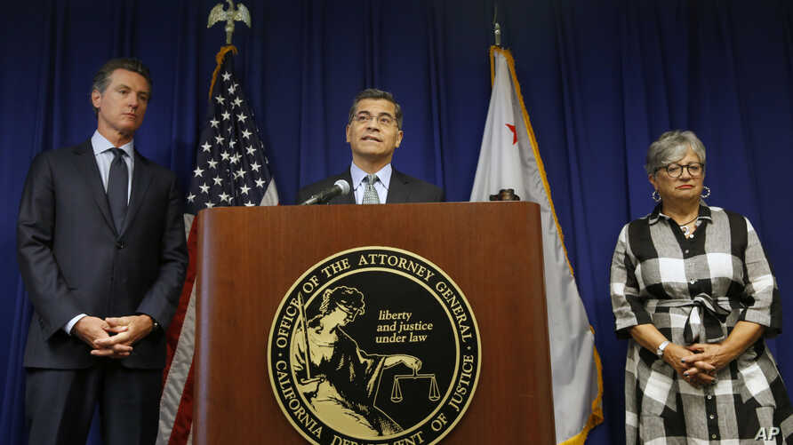 California Attorney General Xavier Becerra, with Gov. Gavin Newsom and state Air Resources Board Chair Mary Nichols, discusses the U.S. government pledge to revoke California's authority to set vehicle emissions standards, in Sacramento, Sept, 18, 2019.