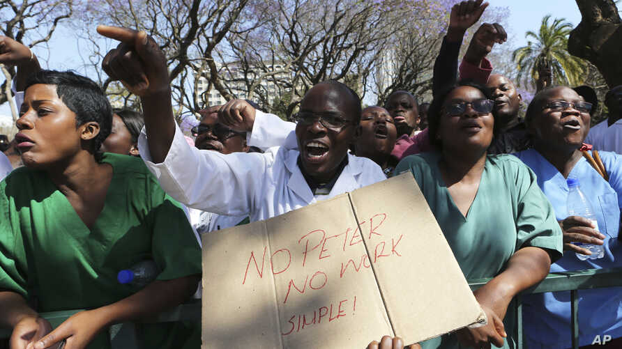 Zimbabwean medical staff march on the streets of Harare, Sept. 19, 2019.