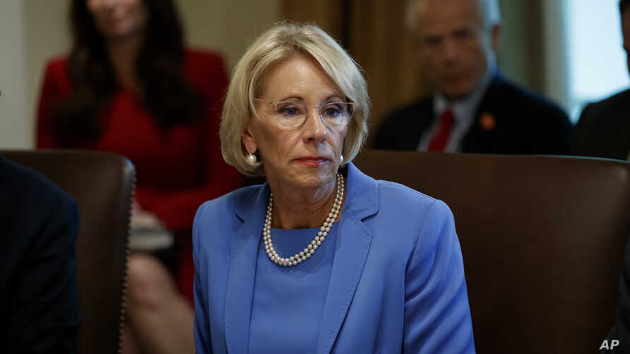 "FILE - Education Secretary Betsy DeVos is threatening to cut funding to a Middle East studies program at the University of North Carolina and Duke University, saying it advances ""ideological priorities"" and unfairly promotes ""positive aspects of Islam."""
