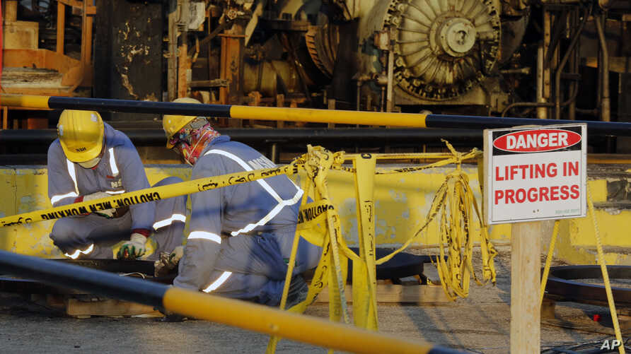 During a trip organized by Saudi information ministry, workers fix the damage in Aramco's oil processing facility after the recent Sept. 14 attack in Abqaiq, near Dammam in the Kingdom's Eastern Province, Sept. 20, 2019.