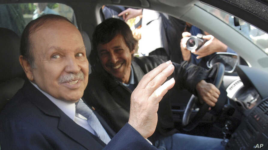 FILE - Algerian President Abdelaziz Bouteflika, left, and his brother Said Bouteflika arrive at campaign headquarters in the Hydra district of Algiers, April 10, 2009.